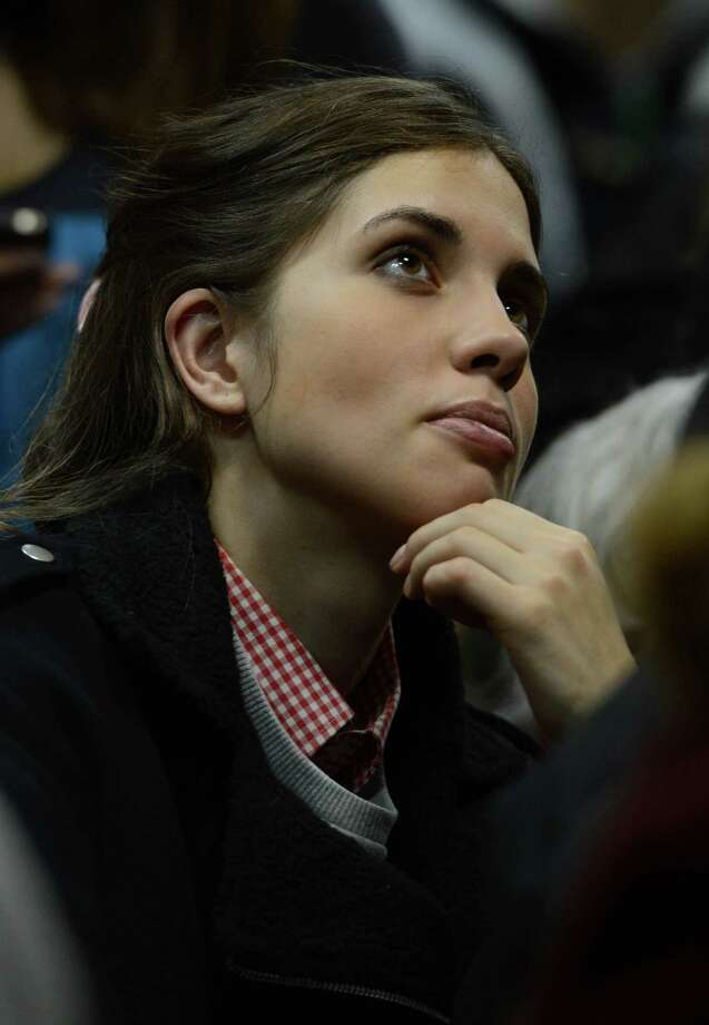 "Nadezhda Tolokonnikova a member of Pussy Riot music club, comes to the court on January 9, 2014 to attend the ""Bolotnaya trial"" took action after an indignation meeting against Vlaidmir Putin at Bolotnaya Spuare in 2012, Moscow, Russia. Photo: Anadolu Agency, Getty Images / 2014 Anadolu Agency"