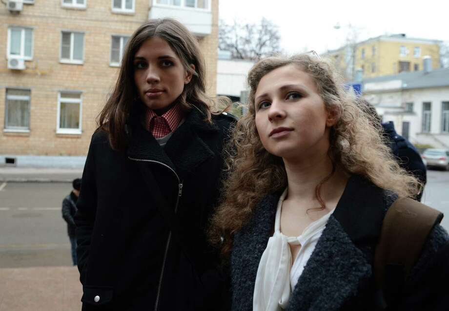 "Maria Alyokhina (R) and  Nadezhda Tolokonnikova (L), members of Pussy Riot music club come to the court on January 9 to attend the ""Bolotnaya trial"" took action after an indignation meeting against Vlaidmir Putin at Bolotnaya Spuare in 2012, Moscow, Russia. Photo: Anadolu Agency, Getty Images / 2014 Anadolu Agency"