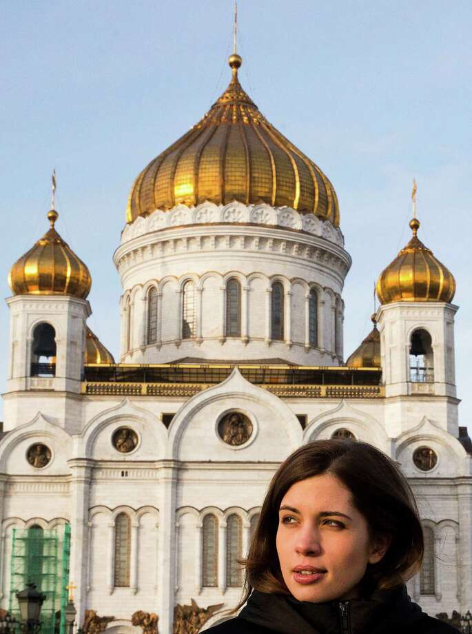 Nadezhda Tolokonnikova of Russian punk group Pussy Riot walks in front of the cathedral of Christ the Savior in Moscow on December 27, 2013. Two freed members of the anti-Kremlin punk group arrived back in Moscow after reuniting in Siberia, ahead of holding their first news conference since their release earlier this week. Their release two months early from their two-year prison terms came after an amnesty backed by Russian President Vladimir Putin. AFP PHOTO/YEVGENY FELDMAN Photo: AFP, Getty Images / 2013 AFP