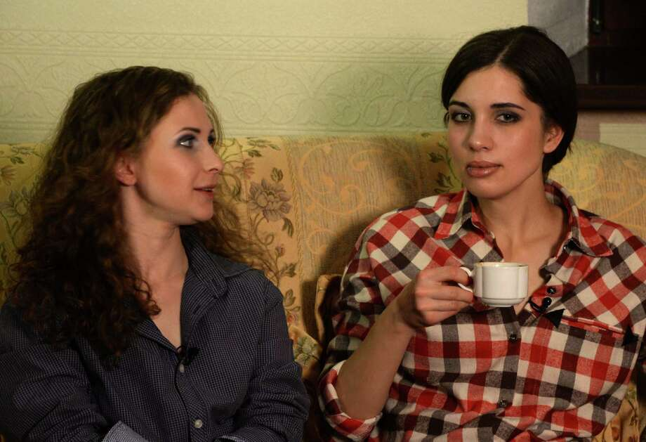 Two members of anti-Kremlin punk band Pussy Riot, Nadezhda Tolokonnikova (R) and Maria Alyokhina speak with journalists at hotel in the Siberian city of Krasnoyarsk, some 3500 km (2174 miles) east of Moscow, on December 24, 2013. The two jailed members of anti-Kremlin punk band Pussy Riot, whose imprisonment prompted a wave of global outrage, walked free yesterday and immediately vowed to fight injustice in Russian prisons. AFP PHOTO/VASILY MAXIMOV Photo: AFP, Getty Images / 2013 AFP