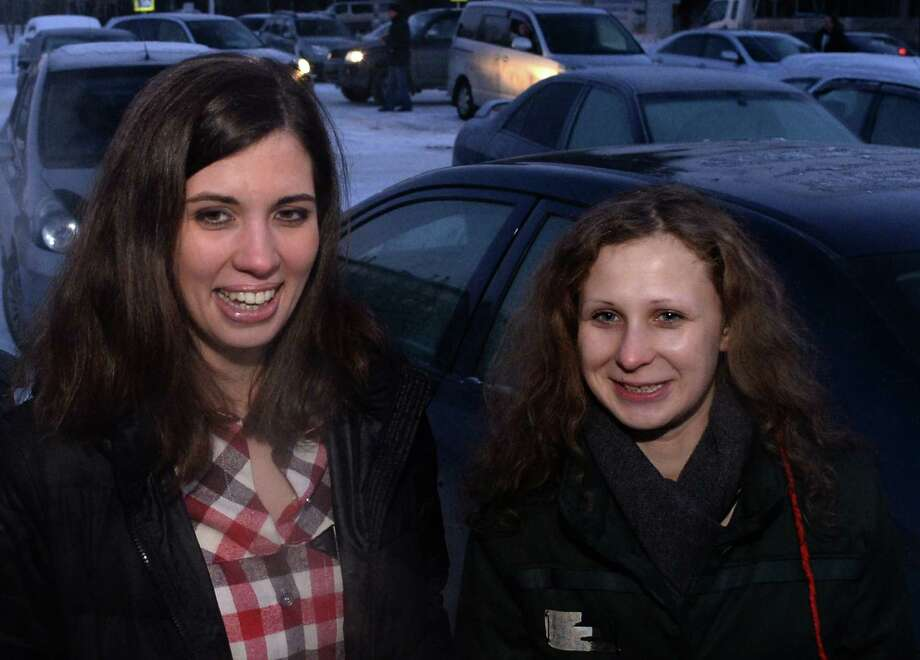 Two members of anti-Kremlin punk band Pussy Riot, Nadezhda Tolokonnikova (L) and Maria Alyokhina smile as they meet in the airport of the Siberian city of Krasnoyarsk, some 3500 km (2174 miles) east of Moscow, on December 24, 2013. The two jailed members of anti-Kremlin punk band Pussy Riot, whose imprisonment prompted a wave of global outrage, walked free yesterday and immediately vowed to fight injustice in Russian prisons. AFP PHOTO/VASILY MAXIMOV Photo: AFP, Getty Images / 2013 AFP