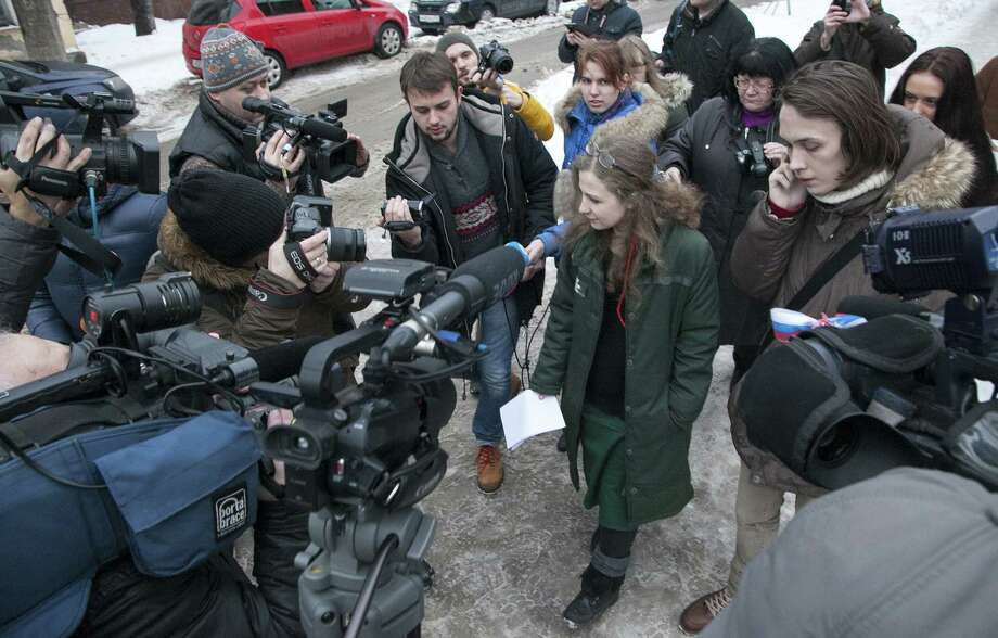Maria Alyokhina, one of the jailed members of anti-Kremlin punk band Pussy Riot, is surrounded by journalists as she walks after beeing freed in Nizhny Novgorod on December 23, 2013. Alyokhina, who was freed from prison under a Kremlin-backed amnesty slammed the measure as a mere publicity stunt and said that she would have preferred to remain in prison.    AFP PHOTO / ANASTASIYA MAKARYCHEVA Photo: AFP, Getty Images / 2013 AFP