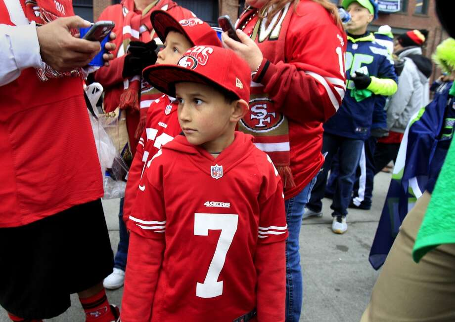 Members of the Olvera family from Rohnert Park, Calif. looked around at all the Seahawk fans Sunday January 19, 2014. The San Francisco 49ers meet the Seattle Seahawks for the NFC title at CenturyLink field in Seattle, Washington. Photo: The Chronicle