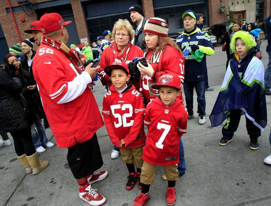 Members of the Olvera family from Rohnert Park, Calif. waited to enter the stadium Sunday January 19, 2014. The San Francisco 49ers meet the Seattle Seahawks for the NFC title at CenturyLink field in Seattle, Washington. Photo: The Chronicle