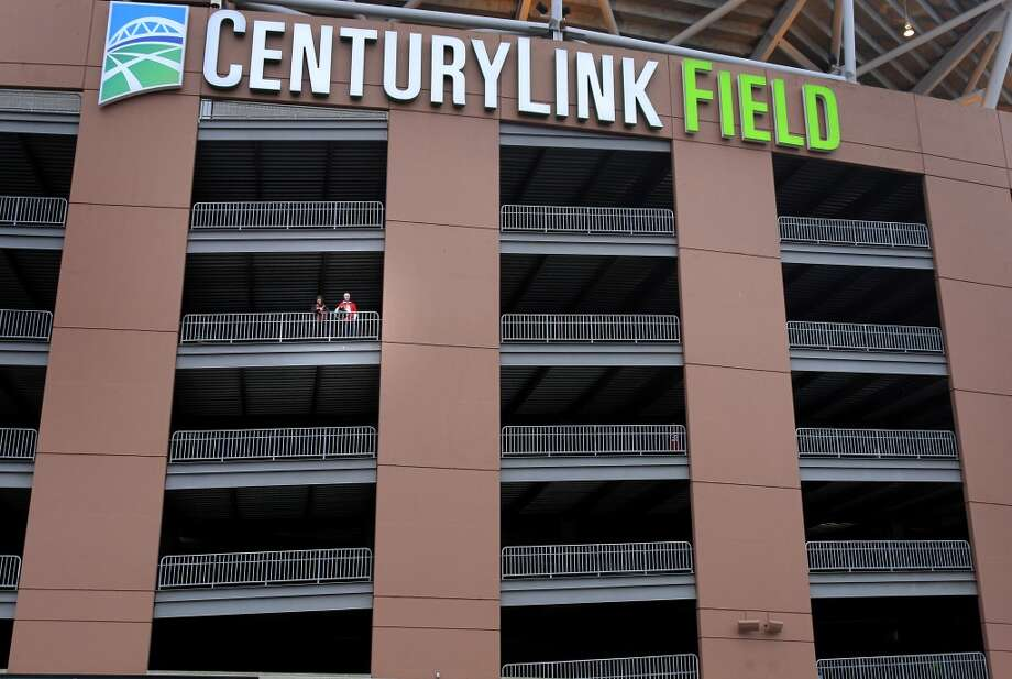 A couple of 49er fans dressed in red must have felt lonely as they paused on a walkway at CenturyLink Field Sunday January 19, 2014. The San Francisco 49ers meet the Seattle Seahawks for the NFC title at CenturyLink field in Seattle, Washington. Photo: The Chronicle