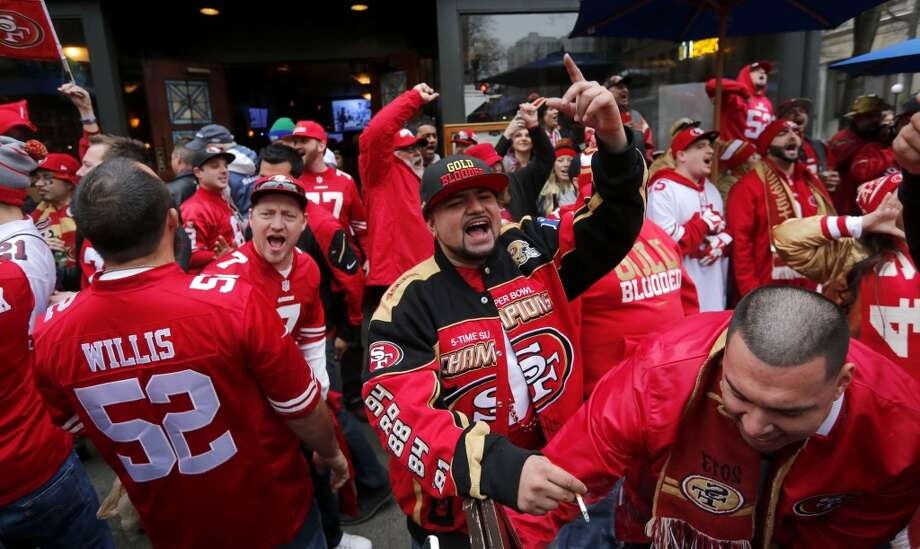49er fans including Robi Rodriquez, from Hercules, (center) joins supporters as the gather downtown before the start of the game as the San Francisco 49ers prepare to take on the Seattle Seahawks in the NFC Championship game at CenturyLink Field in Seattle, Washington on Sunday Jan. 19,  2014. Photo: The Chronicle