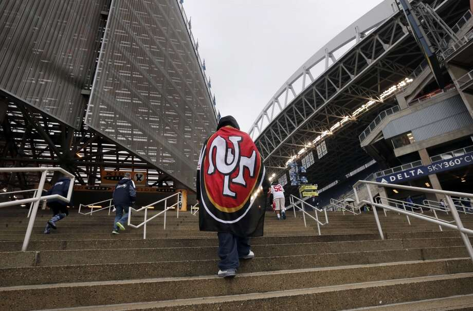 49er fan, Donny Duke, from Utah climbs the steps to get his first look at the stadium, before the start of the game as the San Francisco 49ers prepare to take on the Seattle Seahawks in the NFC Championship game at CenturyLink Field in Seattle, Washington on Sunday Jan. 19,  2014. Photo: The Chronicle