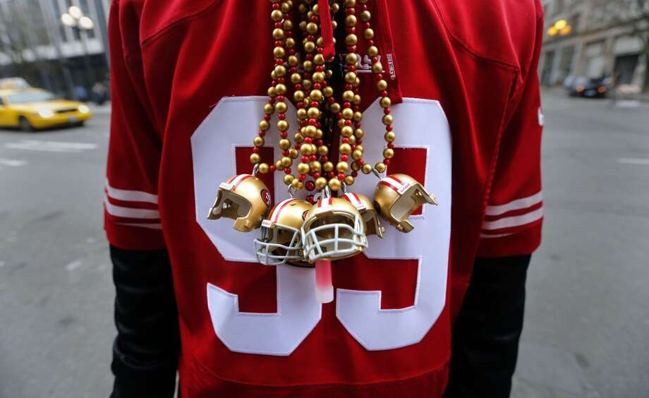 49er fan Michael Pannier of Fairfield displays his five helmet necklaces representing San Francisco's five super bowls before the start of the game as the San Francisco 49ers prepare to take on the Seattle Seahawks in the NFC Championship game at CenturyLink Field in Seattle, Washington on Sunday Jan. 19,  2014. Photo: The Chronicle