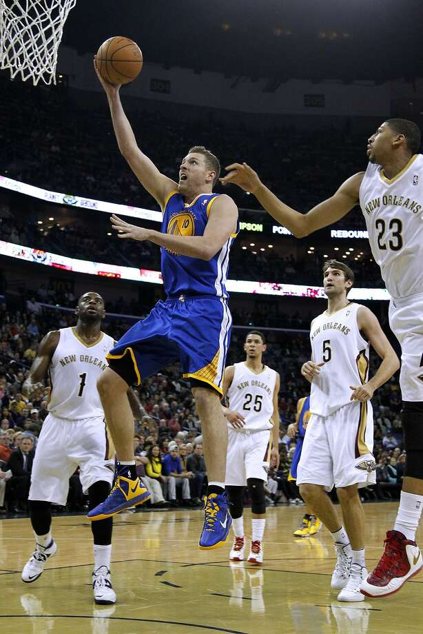Golden State Warriors power forward David Lee (10) drives past New Orleans Pelicans power forward Anthony Davis (23), center Jeff Withey (5), and point guard Tyreke Evans (1) during the first half of an NBA basketball game in New Orleans, Saturday, Jan. 18, 2014. (AP Photo/Jonathan Bachman) Photo: Jonathan Bachman, Associated Press