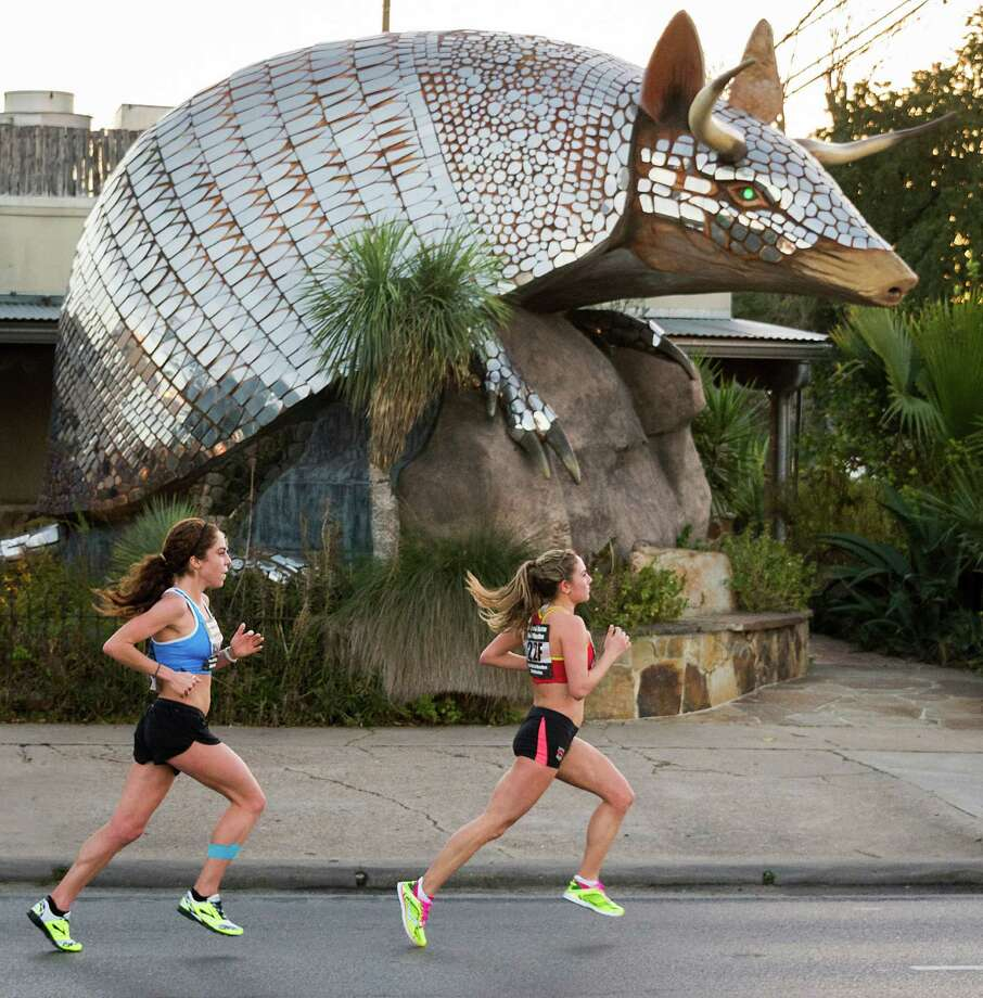 Kara Lubieniecki, right, and Alia Gray pass the Armadillo Palace on Kirby Drive during the US Half Marathon Championships. Photo: Smiley N. Pool, Houston Chronicle / © 2014  Houston Chronicle
