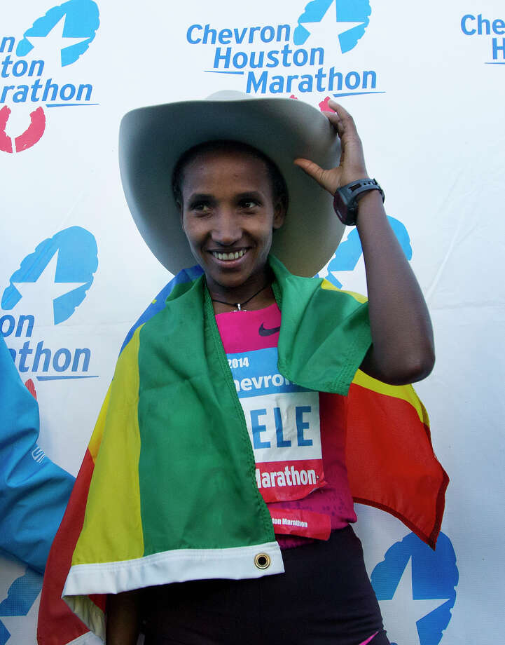 Abebech Bekele adjusts her cowboy hat after winning the Chevron Houston Marathon with a time of 2:25:52. Photo: Cody Duty, Houston Chronicle / © 2014 Houston Chronicle