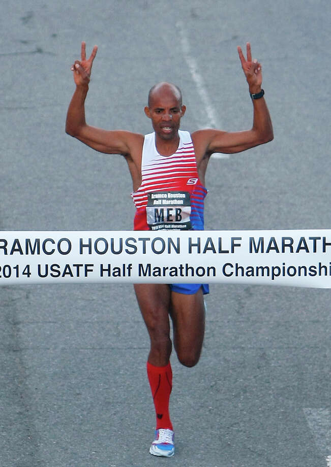 Meb Keflezigui crosses the finish line with a 62:02 finish to win the Aramco Houston Half Marathon. Photo: Cody Duty, Houston Chronicle / © 2014 Houston Chronicle