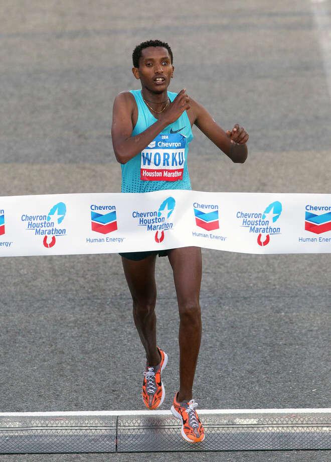 Bazu Worku, of Ethiopia, crosses the finish line of the Chevron Houston Marathon to win with a time of 2:07:32. Photo: Cody Duty, Houston Chronicle / © 2014 Houston Chronicle