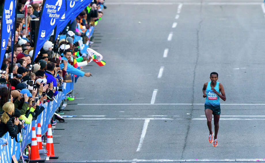 Bazu Worku, of Ethiopia, nears the finish line of the Chevron Houston Marathon to win with a time of 2:07:32. Photo: Cody Duty, Houston Chronicle / © 2014 Houston Chronicle