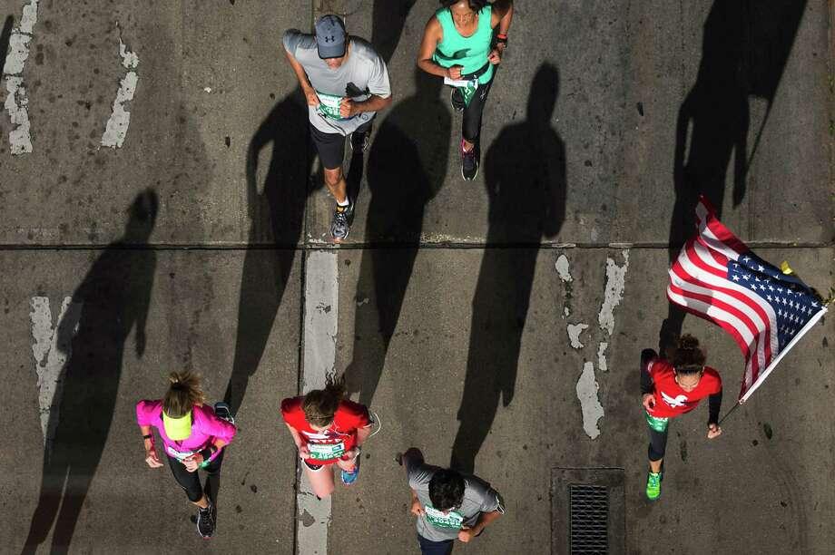 Runners head to the finish of the Aramco Houston Half Marathon. Photo: Smiley N. Pool, Houston Chronicle / © 2014  Houston Chronicle