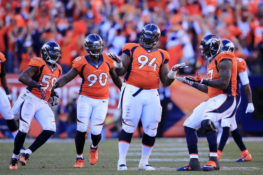 Broncos defenders react after recording a sack on Patriots quarterback Tom Brady. Photo: Jamie Squire, Getty Images