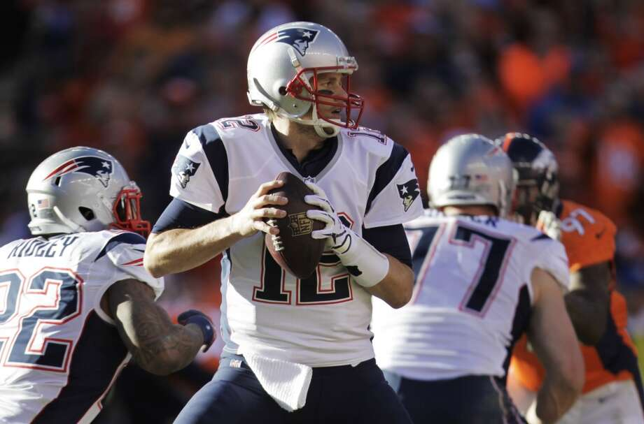 Patriots quarterback Tom Brady looks for a receiver against the Broncos. Photo: Joe Mahoney, Associated Press