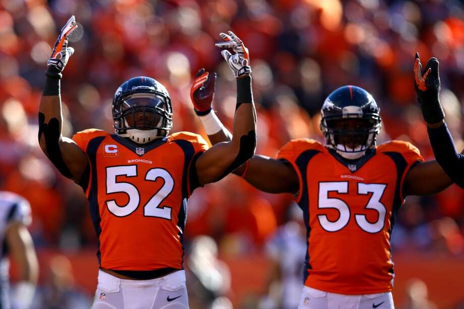 Wesley Woodyard (52) and Steven Johnson (53) of the Denver Broncos react in the second quarter against the New England Patriots Photo: Doug Pensinger, Getty Images