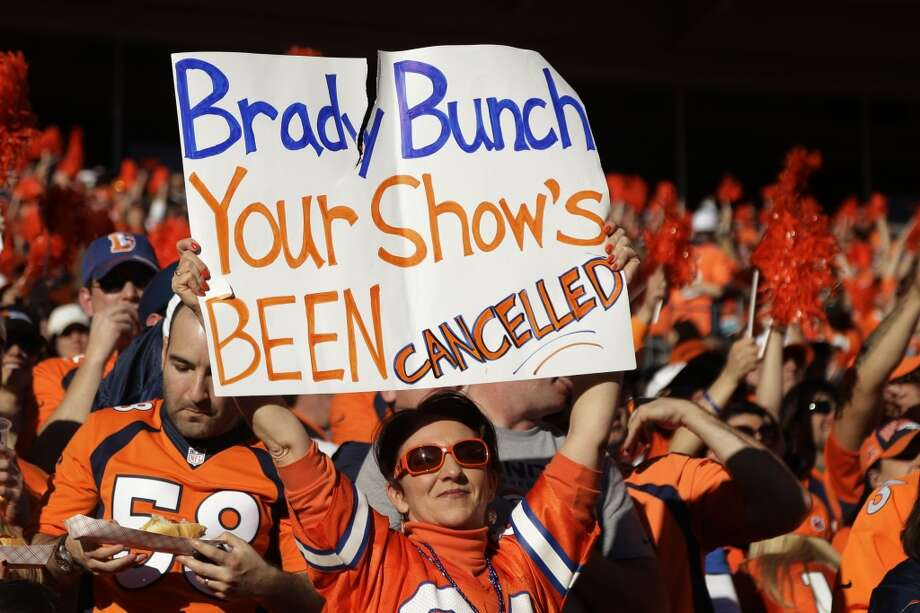 Denver fans show their support for the Broncos in the AFC Championship game. Photo: Charlie Riedel, Associated Press