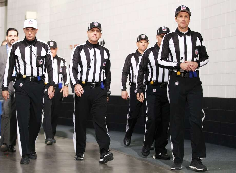 NFL referees get ready for the AFC Championship game between the Broncos and Patriots. Photo: Doug Pensinger, Getty Images