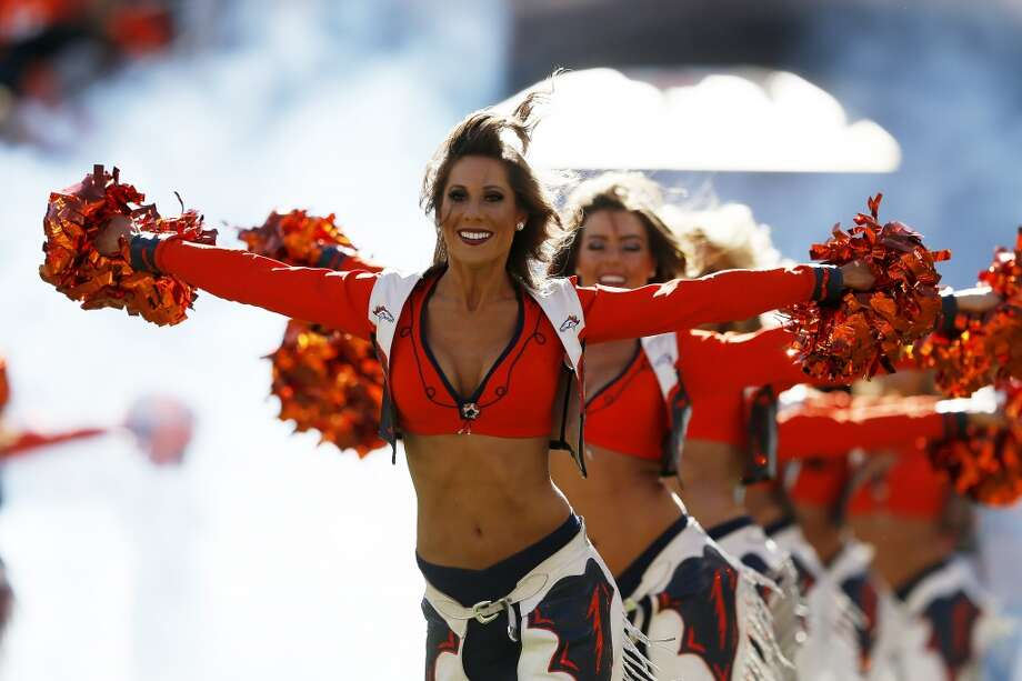 Denver cheerleaders show their support for the Broncos in the AFC Championship game. Photo: Kevin C. Cox, Getty Images