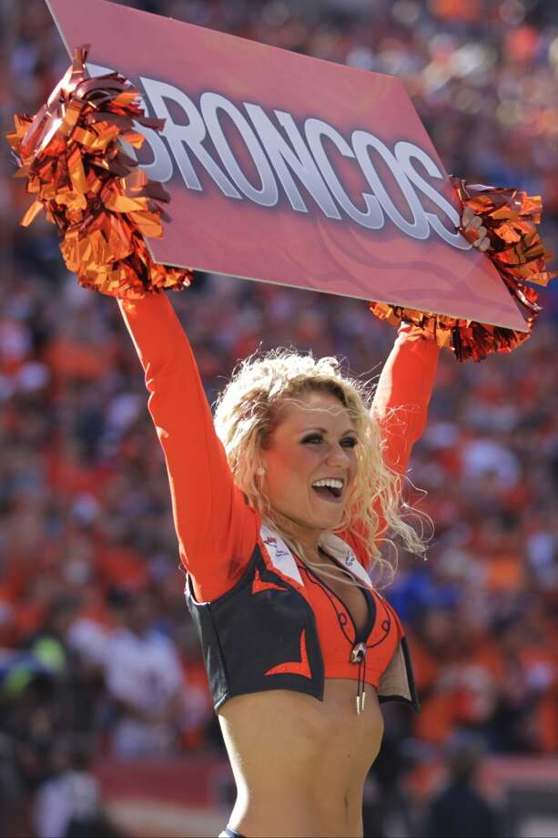 A cheerleader supports the Broncos before the AFC Championship game against the Patriots. Photo: Joe Mahoney, Associated Press