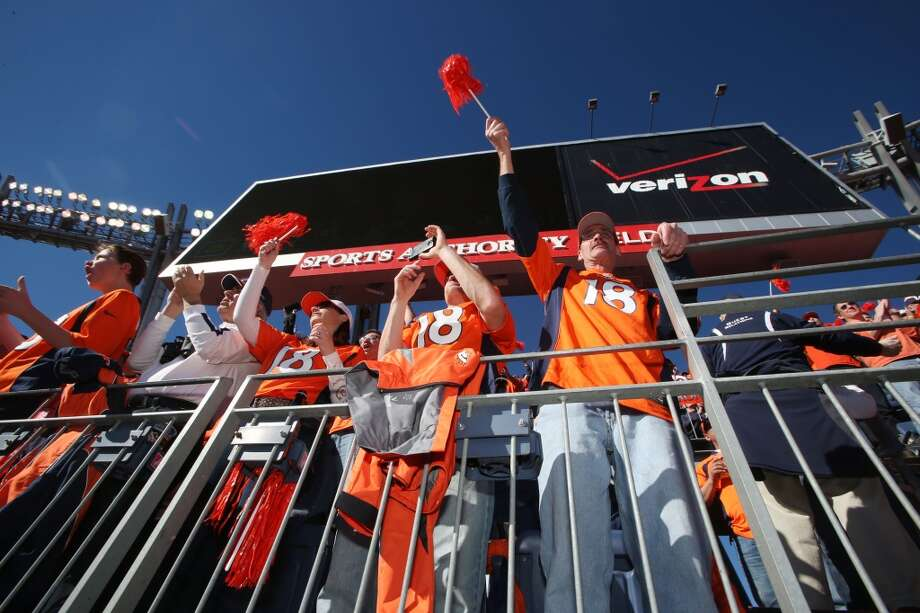 Broncos fans get ready to watch their team play the Patriots for the AFC Championship game at Sports Authority Field in Denver. Photo: David Zalubowski, Associated Press