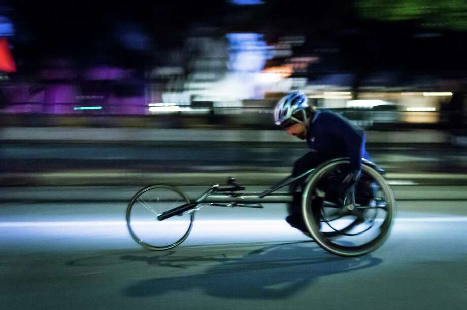 A wheelchair athlete races away from the start line. Photo: Smiley N. Pool, Houston Chronicle / © 2014  Houston Chronicle