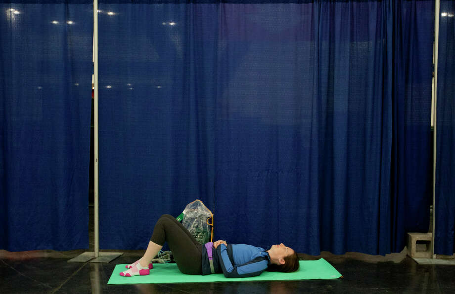 "Bari Fishel rests before running the Aramco Houston Half Marathon. ""I'm only half-crazy,"" she said. Photo: Cody Duty, Houston Chronicle / © 2014 Houston Chronicle"