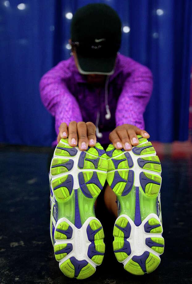 Myra Davis prepares for the Aramco Houston Half Marathon at the George R. Brown Convention Center. Photo: Cody Duty, Houston Chronicle / © 2014 Houston Chronicle