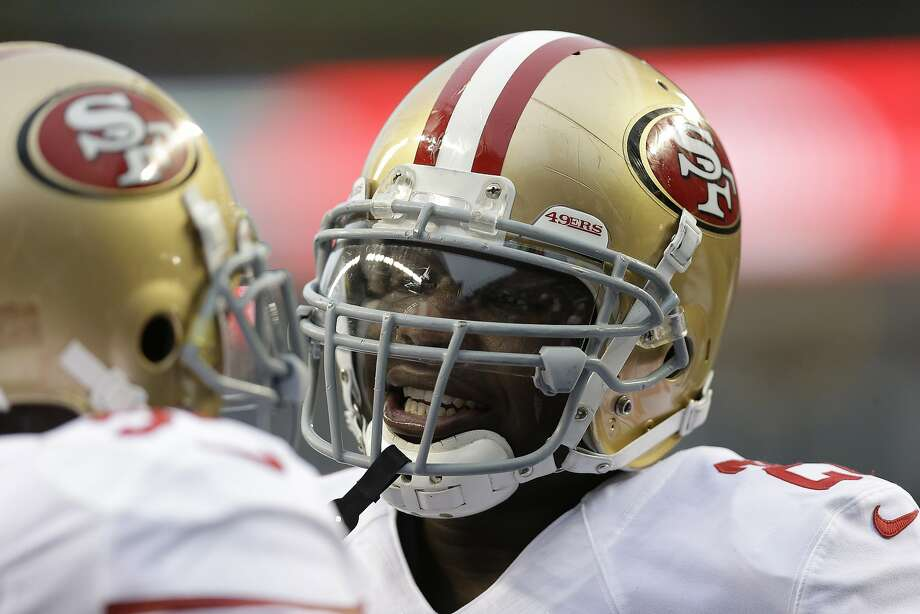 San Francisco 49ers' Frank Gore, right, speaks with a player before the NFL football NFC Championship game against the Seattle Seahawks, Sunday, Jan. 19, 2014, in Seattle. (AP Photo/Marcio Jose Sanchez) Photo: Marcio Jose Sanchez, Associated Press