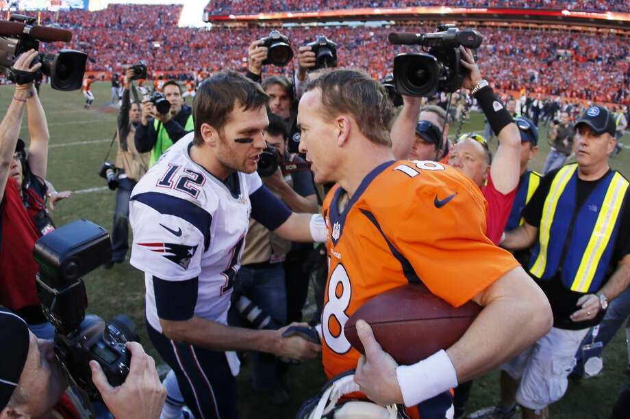 Broncos quarterback Peyton Manning speaks with Patriots quarterback Tom Brady after Denver won the AFC Championship game. Photo: Kevin C. Cox, Getty Images