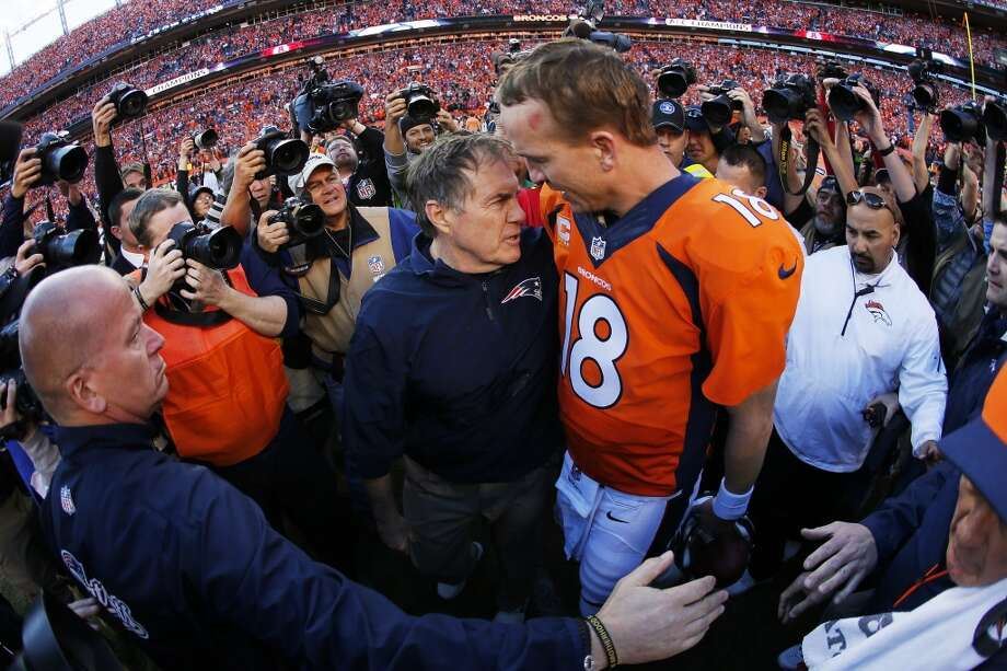 Broncos quarterback Peyton Manning speaks with Patriots head coach Bill Belichick after Denver won the AFC Championship game. Photo: Kevin C. Cox, Getty Images