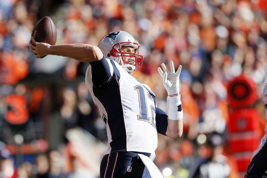 Patriots quarterback Tom Brady looks to throw against the Broncos. Photo: Kevin C. Cox, Getty Images