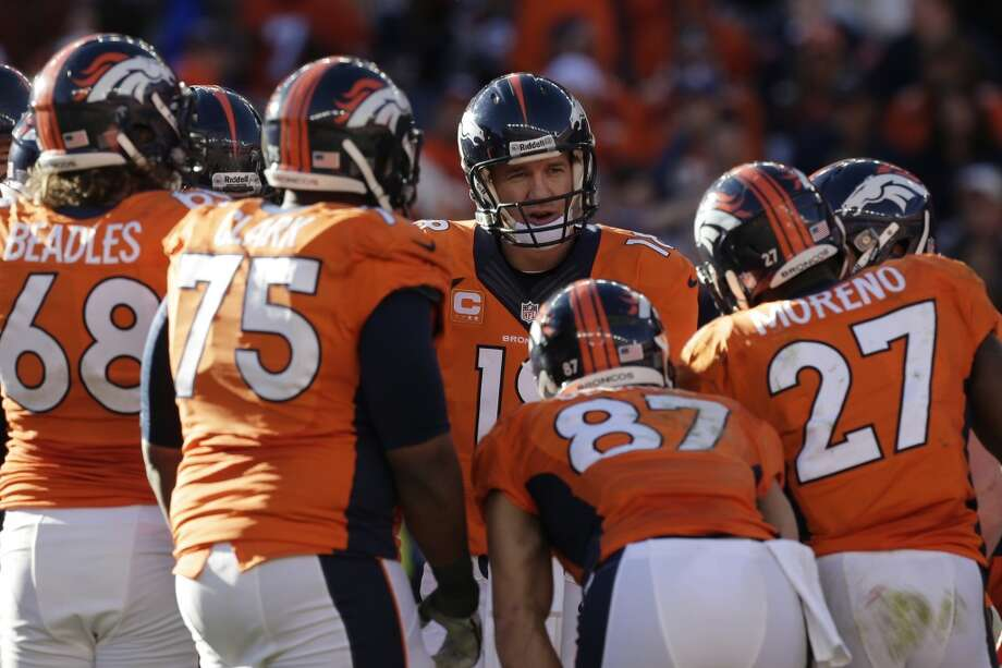 Broncos quarterback Peyton Manning and his teamamtes in the huddle. Photo: Julie Jacobson, Associated Press
