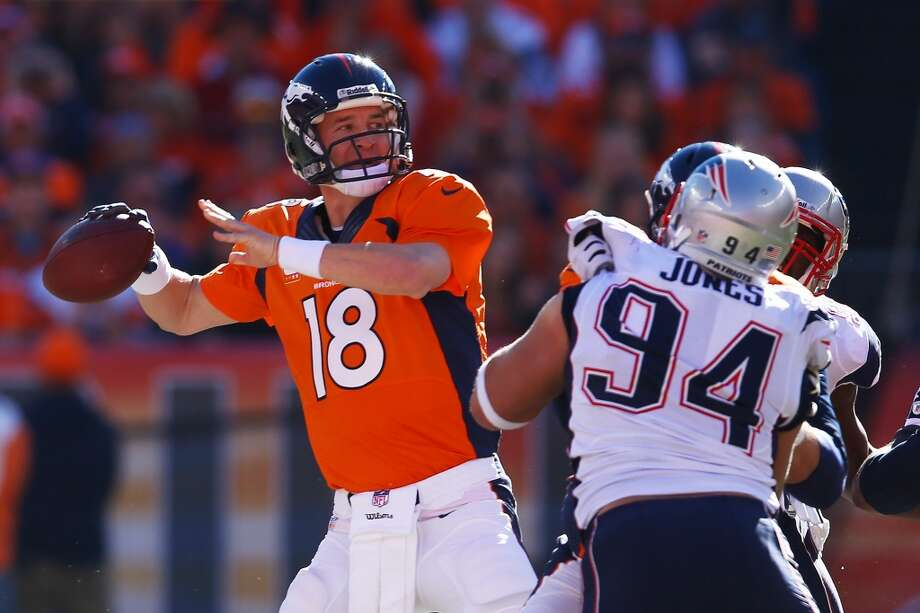 Broncos quarterback Peyton Manning looks to throw against the Patriots. Photo: Doug Pensinger, Getty Images