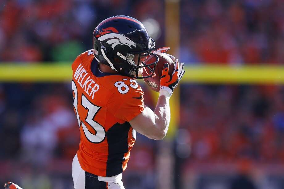 Broncos receiver Wes Welker makes a reception against the Patriots. Photo: Kevin C. Cox, Getty Images