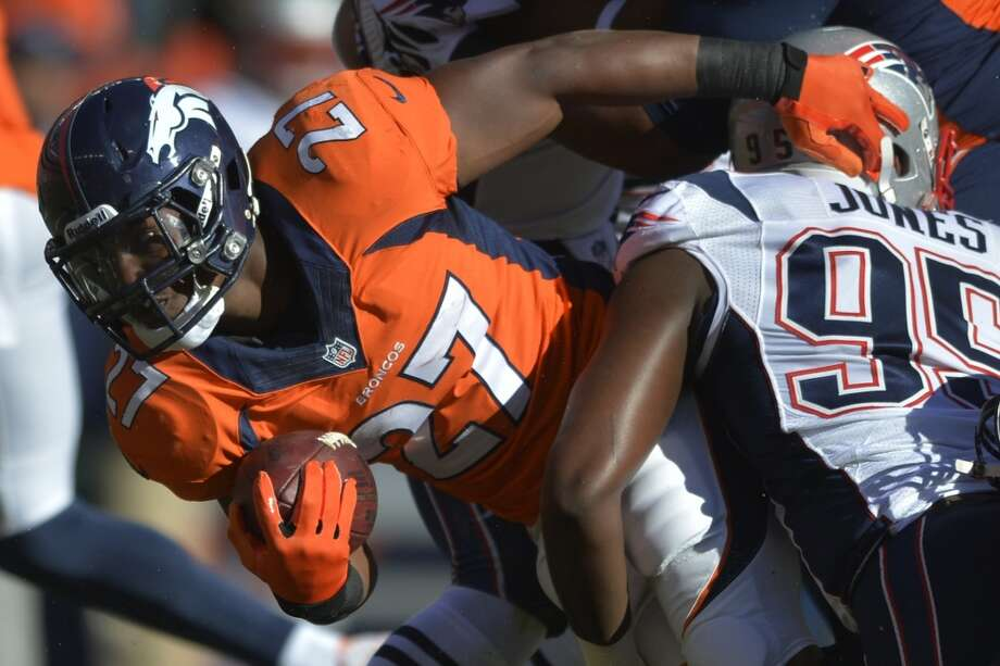 Broncos running back Knowshon Moreno is tackled against the Patriots. Photo: Jack Dempsey, Associated Press