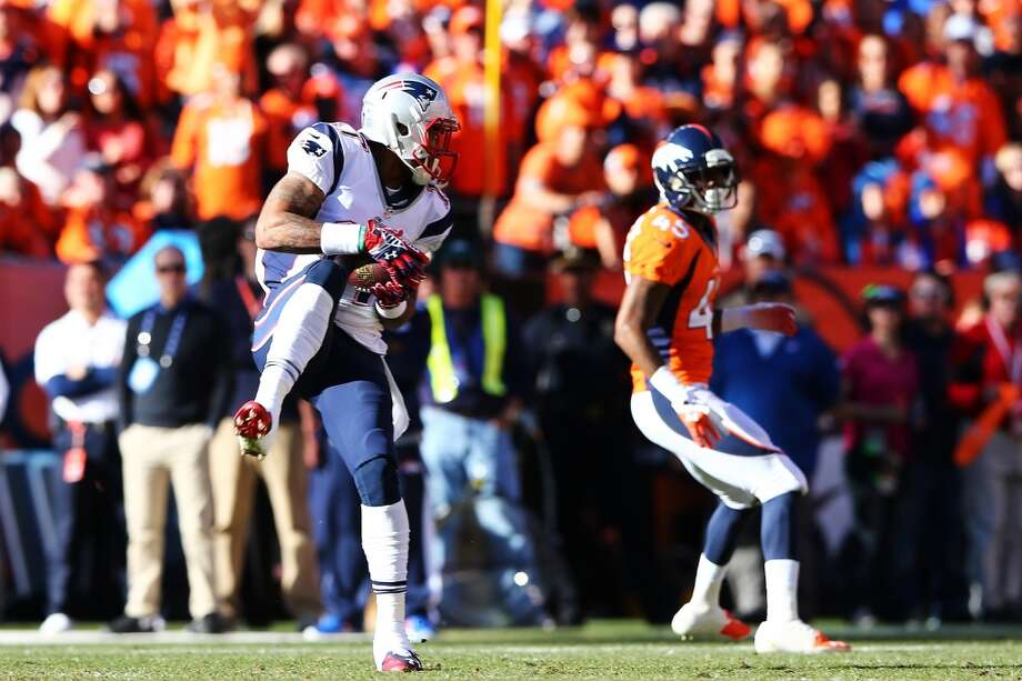 Aaron Dobson of the Patriots makes a reception against the Broncos. Photo: Elsa, Getty Images