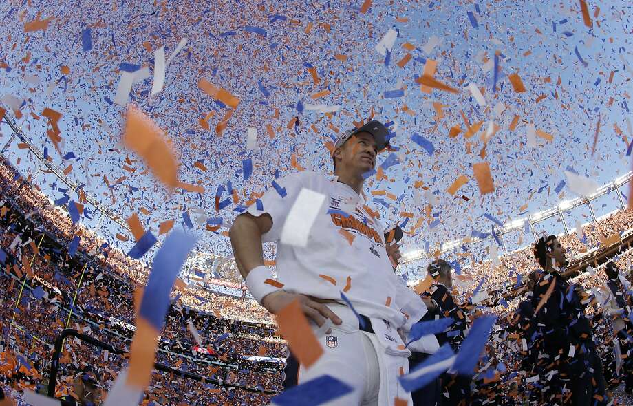 Peyton Manning is the object of confetti and affection after guiding the Broncos to their first Super Bowl in 15 years and his first Super Bowl in four. Photo: Charlie Riedel, Associated Press