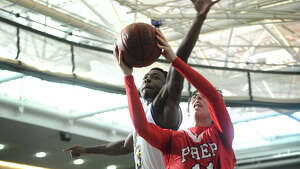 Fairfield Prep's David Zielinski drives to the basket ahead of Career High School defender Amos Ford during their boys basketball matchup at the Floyd Little Athletic Center in New Haven, Conn. on Sunday, January 19, 2014.