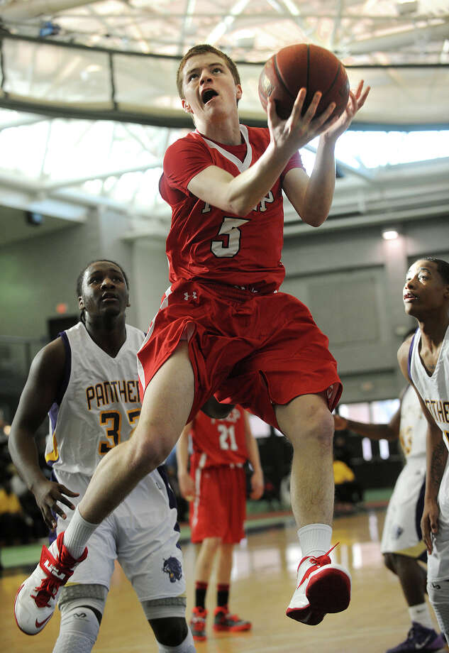Fairfield Prep's Thomas Nolan drives to the basket ahead of a pair of Career High School defenders during their boys basketball matchup at the Floyd Little Athletic Center in New Haven, Conn. on Sunday, January 19, 2014. Photo: Brian A. Pounds / Connecticut Post
