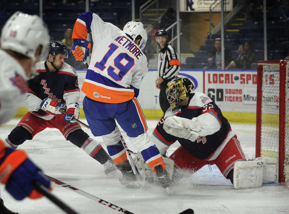 Sound Tiger Riley Wetmore looks to stuff the puck past Hartford goalie David LeNeveu during the second period of their AHL hockey matchup at the Webster Bank Arena in Bridgeport, Conn. on Sunday, January 19, 2014. Photo: Brian A. Pounds / Connecticut Post