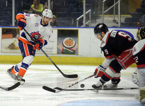 Sound Tiger Pierre-Marc Bouchard fires a shot on goal during his team's AHL hockey matchup with Hartford at the Webster Bank Arena in Bridgeport, Conn. on Sunday, January 19, 2014.