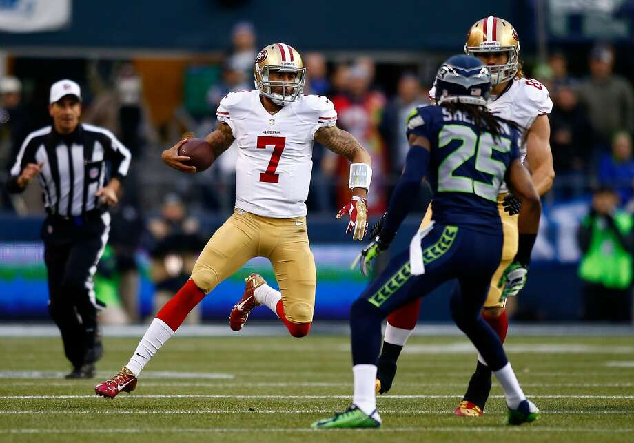 SEATTLE, WA - JANUARY 19:  Quarterback Colin Kaepernick #7 of the San Francisco 49ers runs the ball in the first half against the Seattle Seahawks during the 2014 NFC Championship at CenturyLink Field on January 19, 2014 in Seattle, Washington.  (Photo by Jonathan Ferrey/Getty Images) Photo: Jonathan Ferrey, Getty Images