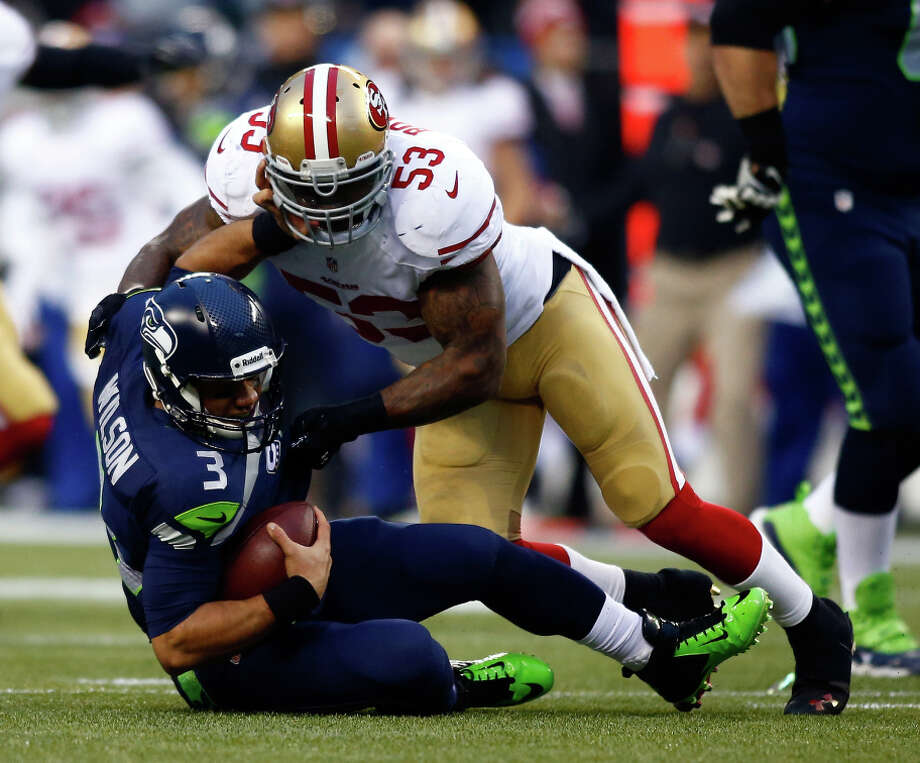 SEATTLE, WA - JANUARY 19:  Quarterback Russell Wilson #3 of the Seattle Seahawks is hit by inside linebacker NaVorro Bowman #53 of the San Francisco 49ers in the first half during the 2014 NFC Championship at CenturyLink Field on January 19, 2014 in Seattle, Washington.  (Photo by Jonathan Ferrey/Getty Images) Photo: Jonathan Ferrey / Getty Images / 2014 Getty Images