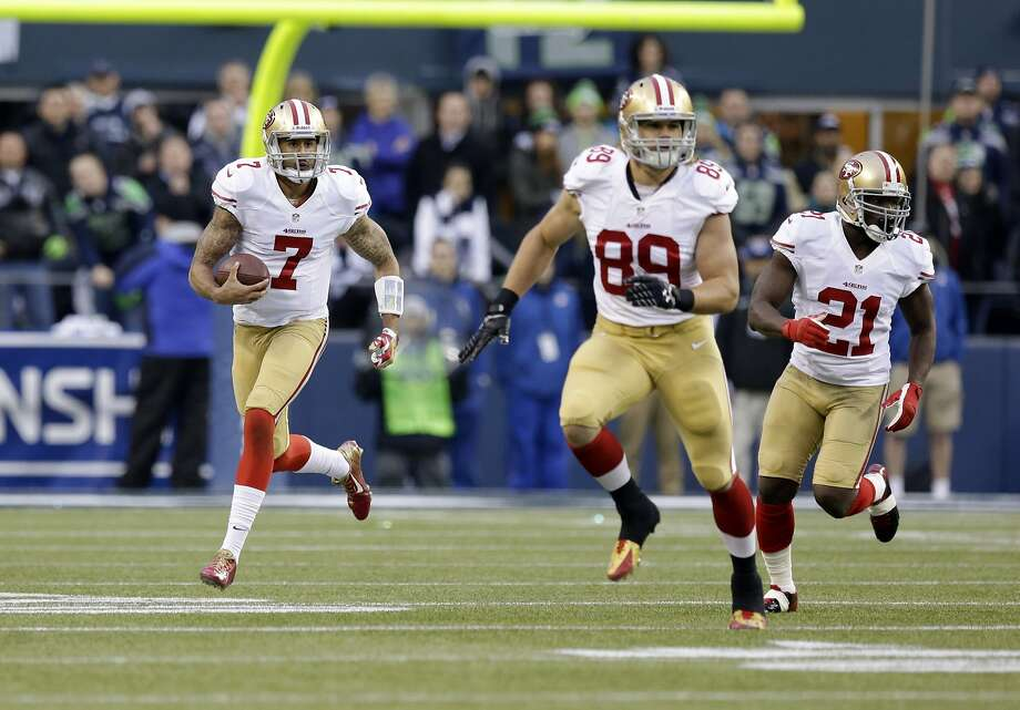 San Francisco 49ers' Colin Kaepernick (7) works against the Seattle Seahawks with San Francisco 49ers' Vance McDonald (89) and San Francisco 49ers' Frank Gore during the first half of the NFL football NFC Championship game Sunday, Jan. 19, 2014, in Seattle.  (AP Photo/Elaine Thompson) Photo: Elaine Thompson, Associated Press