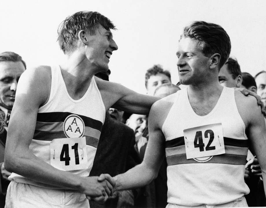 Christopher Chataway (right) congratulated Roger Bannister after Bannister's sub-4-minute mile, May 6, 1954. Photo: Associated Press