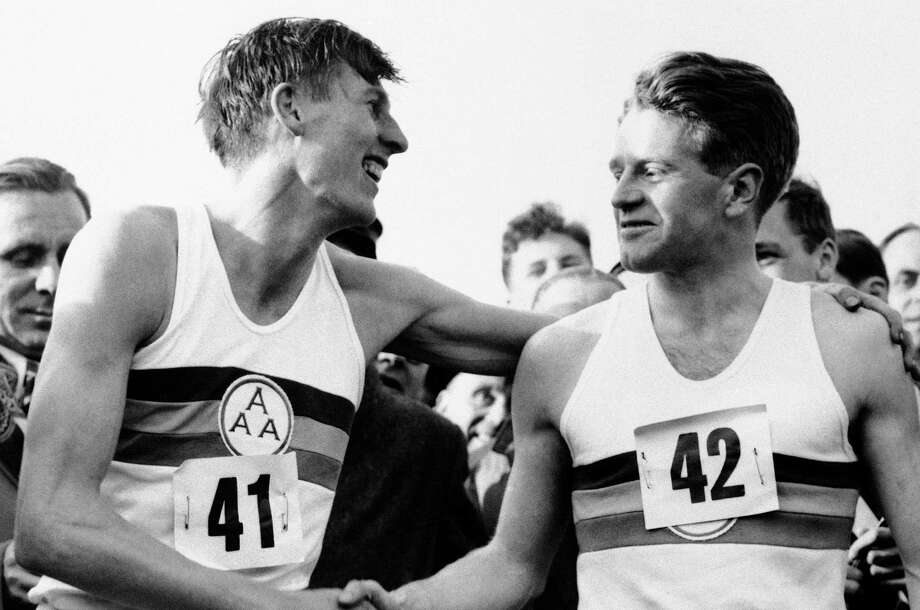 Chris Chataway (right), with Roger Bannister, played a big part in Bannister running the first sub-4-minute mile. Photo: Associated Press File Photo / AP