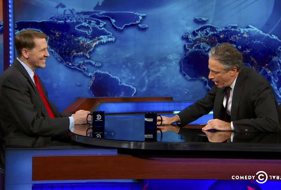 Richard Cordray (left), director of the Consumer Financial Protection Bureau, talks with host Jon Stewart about debt traps, mortgage reform and fixing the financial industry on his TV show recently. Photo: Comedy Central / New York Times / COMEDY CENTRAL